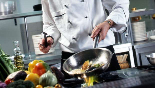 chef-with-pan-on-stove